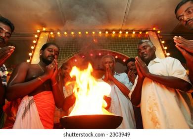 Hindu devotee recites prayer at a temple, 2004.