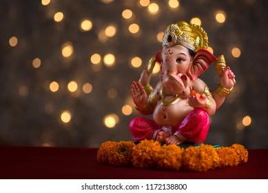 Hindu God Ganesha on Blured bokhe background, Ganesha Idol.