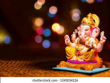 Hindu God Ganesha on blurred bokhe background Ganesha Idol