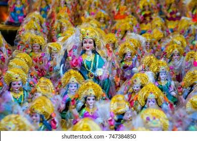 Hindu goddess, Colorful clay idol of goddess laxmi, Hindu religion and Indian celebration of Diwali festival