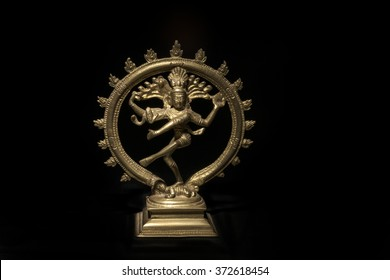 the Hindu goddess Shiva in bronze on black background