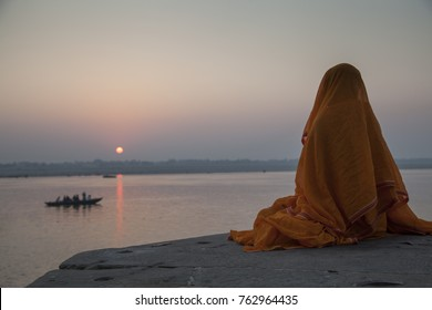 Hindu Monk is meditating at Ganges River