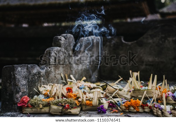 Hindu offering placed in a Bali temple during a purification ritual. Travel concept.