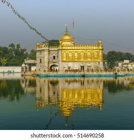 The Hindu pilgrimages visit the Silver Temple stands in the middle of the sacred pond in Amritsar, Punjab, India on October, 21 2016