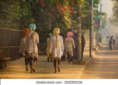 Hindu pilgrims walk barefoot  sand parikrama around Govardhan hill