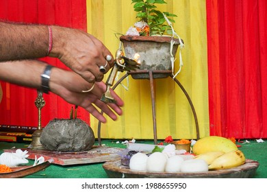 Hindu priest lighting up holy fire or holy light for worshipping idol of God Jagannath, Balaram and Suvodra. Ratha jatra festival is famous Hindu festival in India. Howrah, West Bengal, India.