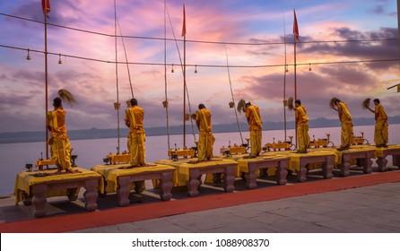 Hindu priests perform traditional prayer known as the Ganga Aarti ritual at the river ghat at Varanasi India at sunrise.