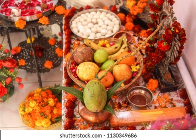Hindu puja. Incense, offerings, fruits, sweets, rose petals, marigold flowers, statues of the gods. Traditional, indian, religion, holiday, Navratri, still life, asian.