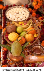 Hindu puja. Incense, offerings, fruits, coconut, sweets, rose petals, marigold flowers, statues of the gods. Traditional, indian, altar, religion, holiday, Navratri, still life, south asian.