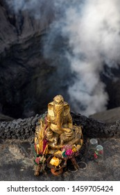 Hindu sacrificial altar with gold elephant Ganesha on volcano crater