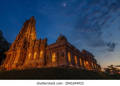 Hindu temple lighted up during a sunset