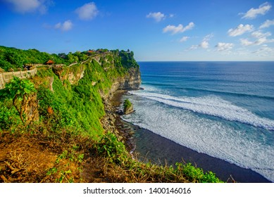 The hindu temple Pura Luhur Uluwatu situated over the cliffs of South Kuta, Bali, Indonesia
