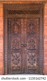 Hindu temple wooden door in Bhaktapur, Nepal. Carved decoration and figures of hindu gods.
