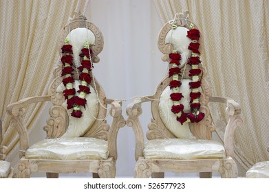 Hindu Wedding Chairs for the Bride and Groom with Garlands that the Bride and Groom  will exchange in the ceremony.