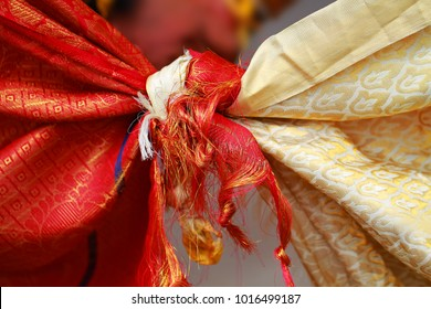 Hindu wedding knot tied with man and woman dress