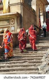 Hindu women climb the steps of Galtaji temple, Jaipur, Rajasthan, India