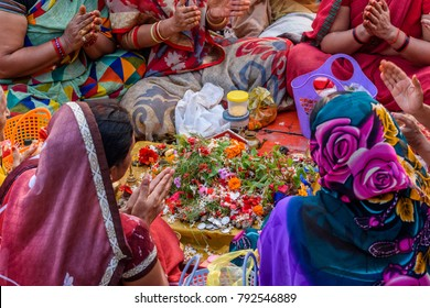 Hindu women  praying mantras as part of a ritual ceremony at the Ganges river ghat Varanasi, India.