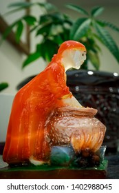 hinduism ancient statuette of the holy man Sai Baba, small statue of lord sai baba who is cooking food with hand