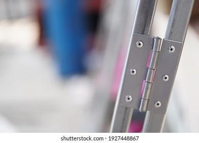 The hinge is fixed to the steel with a rivet.