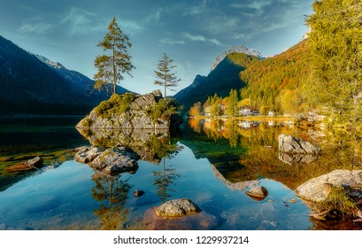 Hintersee lake at sunny day. Wonderful Summer Natural Landscape. Awesome Alpine Highland under sunlight. Amazing Nature Scenery with fairy tale mountain lake and perfect blue sky. best places in World