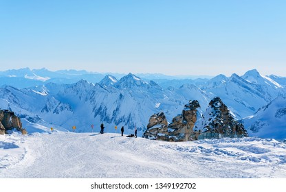 Hintertux Glacier ski resort in Zillertal in Tyrol in Austria in winter in Alps. Alpine mountains with snow. Downhill fun. Family vacation. Blue sky and white slopes.