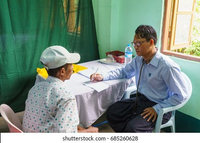 HINTHADA, MYANMAR - AUG 30: Burmese doctor diagnoses people as part of Thai Military Medical assistance team at Htanpingone Health care center on Aug 30, 2015 in Hinthada, Myanmar.