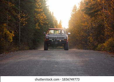 Hinton, Alberta / Canada - 10/2/10: An Old Dodge Pickup Truck Drives Down A Gravel Road In The Backcountry