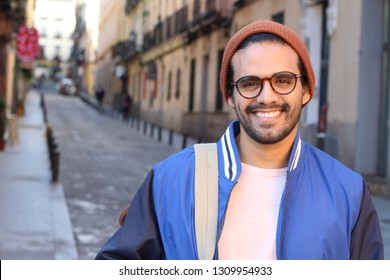 Hip ethnic man smiling outdoors
