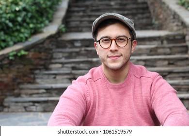 Hip ethnic man wearing eyeglasses and hat