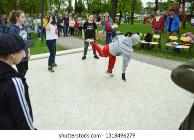 Hip hop dance training, in the urban street, environment, in the evening at park light, shadow mood. Rezekne, Latvia, May 27, 2017