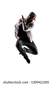 hip hop dancer jumping against white background