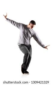 hip hop dancer posing against white background