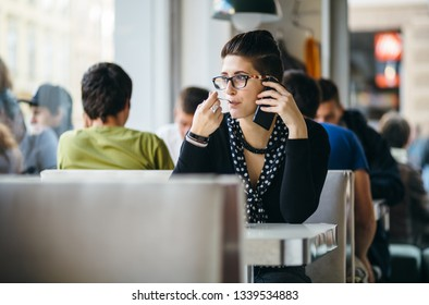 Hip young woman on coffee break in cafe