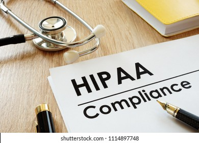 HIPAA Compliance application and stethoscope on a desk.