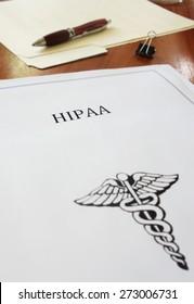 HIPAA healthcare document on an office desk