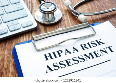 Hipaa risk assessment form and stethoscope.