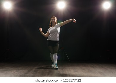 Hip-hop, jazz-funk, tecktonik, waacking, trance and street dances concept - Young woman dancing jazz-funk at studio