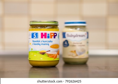 Hipp chicken soup baby food in a glass jar on table in soft focus on circa January 2018 in Poznan, Poland