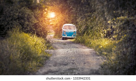 hippie bus on the road in sunset