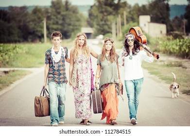 Hippie Group Walking on a Countryside Road,Italy