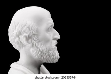 Hippocrates (460-380 B.C.E.) Ancient Greek physician, traditionally regarded as the father of medicine. Sculpture isolated on black background