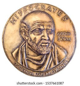 Hippocrates father of medicine - vintage bronze medallion isolated against white background.