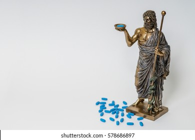 Hippocrates statue and blue pills, reproductive medicine