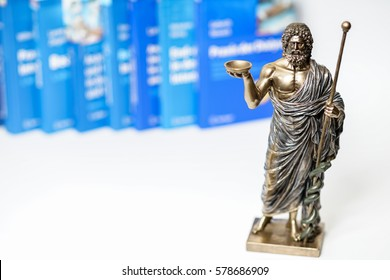 Hippocrates statue and blurred medical books in the background