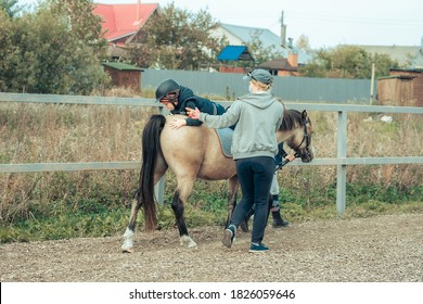 Hippotherapy for young children is the prevention many serious diseases. Concept of spring and summer sports, care, good mood, horse trainings; equistrain club; hippotherapy; vacation and hobby