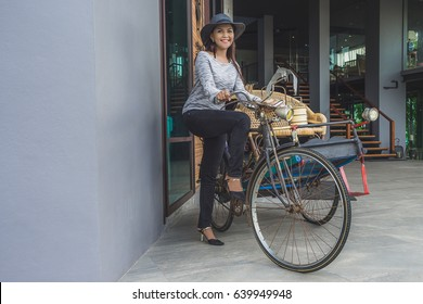 Hipster asian woman with three bicycle, Vintage tricycle bicycle in Thailand