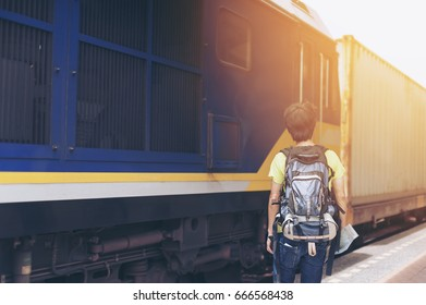 Hipster backpacks Stand at the train station There is a train running background,vintage color, Image for travel and freedom life concept