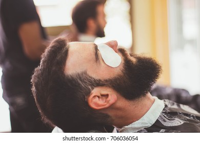Hipster at barber shop with eye protection.