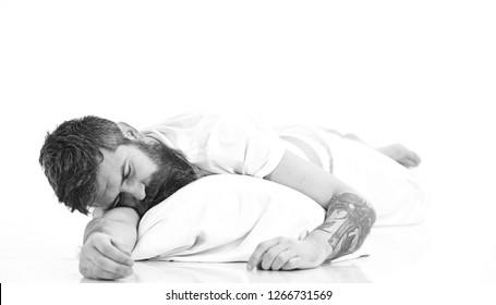 Hipster with beard fall asleep, sleeps well. Guy relaxing, rest, nap, sleep Man with sleepy face lies on pillow. Man with beard and mustache in deep sleep, white background. Deep sleep concept. .