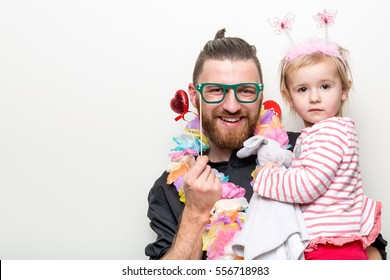 hipster beard guy with little baby girl daughter  in photo booth with floral props separated on white background